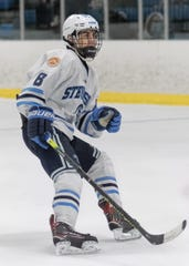 Livonia Stevenson's Ryan Teets skates against Trenton in the MIHL/KLAA Showcase.
