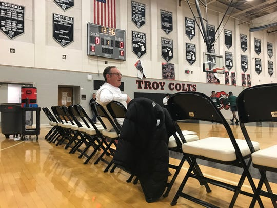 Troy head boys basketball coach Gary Fralick sits before the Colts' game against Novi.
