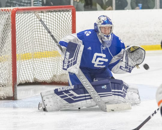 Detroit Catholic Central goalie Louis Finnegan makes a save against Brighton in the MIHL/KLAA Showcase.
