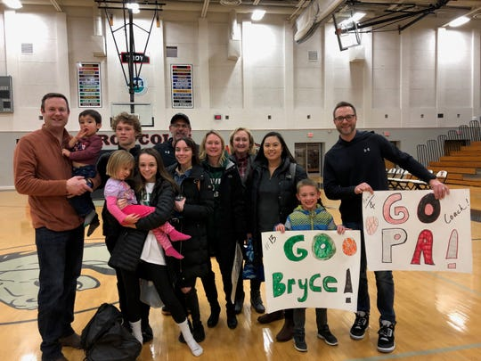 The Lubin and the Fralick families pose for a photo after the Troy/Novi boys basketball game.