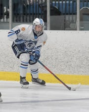 Livonia Stevenson's Kyle Robertson possess the puck against Trenton in the MIHL/KLAA Showcase.
