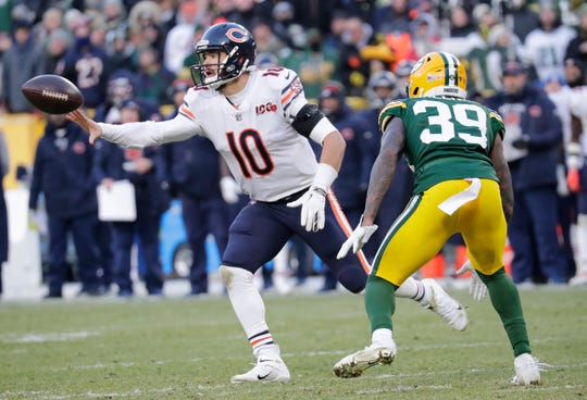 Chicago Bears quarterback Mitchell Trubisky (10) laterals the ball on the last play of the game against Green Bay Packers defensive back Chandon Sullivan (39) Sunday, December 15, 2019, at Lambeau Field in Green Bay, Wis.