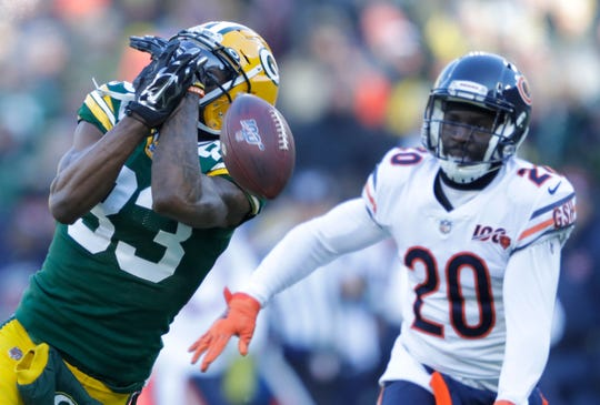 Green Bay Packers wide receiver Marquez Valdes-Scantling (83) drops a pass in the first quarter as he is covered by Chicago Bears cornerback Prince Amukamara (20) Sunday, December 15, 2019, at Lambeau Field in Green Bay, Wis.