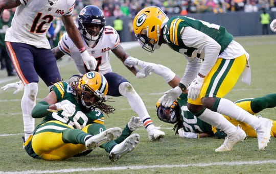 Green Bay Packers cornerback Tramon Williams (38) recovers the ball on the last play of the game to seal the victory against the Chicago Bears Sunday, December 15, 2019, at Lambeau Field in Green Bay, Wis.