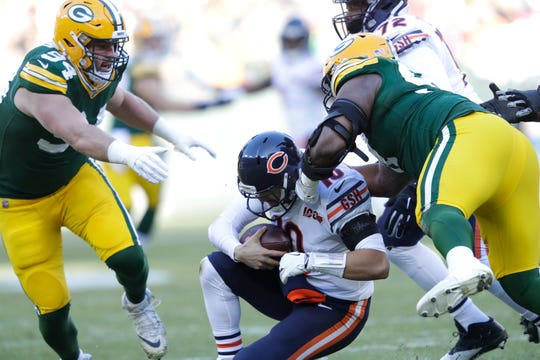 Chicago Bears quarterback Mitchell Trubisky (10) is sacked by Green Bay Packers nose tackle Kenny Clark (97) as Dean Lowry (94) moves in on the play Sunday, December 15, 2019, at Lambeau Field in Green Bay, Wis.