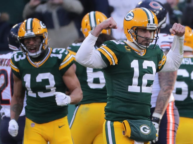 Green Bay Packers quarterback Aaron Rodgers (12) reacts after running back Aaron Jones scored a touchdown on a 2-yard run during the third quarter of their game Sunday, December 15, 2019 at Lambeau Field in Green Bay, Wis. The Green Bay Packers beat the Chicago Bears 21-13.