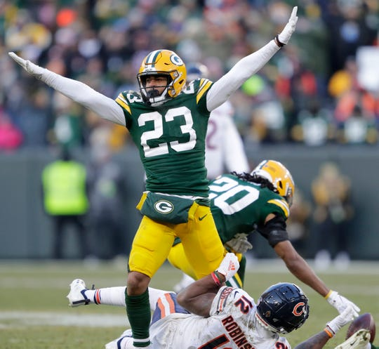 Green Bay Packers cornerback Jaire Alexander (23) celebrates breaking up a pass intended for Chicago Bears wide receiver Allen Robinson (12) with less than two minutes left in the game Sunday, December 15, 2019, at Lambeau Field in Green Bay, Wis.