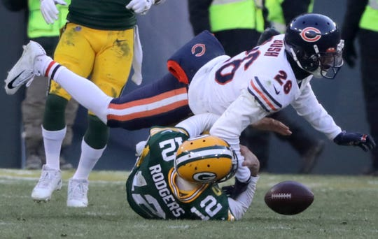 Chicago Bears defensive back Deon Bush (26) knoicks the ball losse while tackl;ing Green Bay Packers quarterback Aaron Rodgers (12) late in the fourth quarter during their football game on Sunday, December 15, 2019, at Lambeau Field in Green Bay, Wis. Rodgers was ruled down.