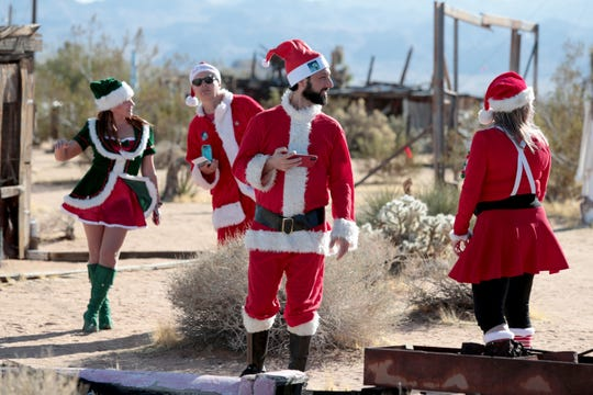Natasha Shelby, Daniel Brenner, Jeffro Sobel and Heather Vescent explore at their second stop of the day,Noah Purifoy Desert Art Museum, as part of the first SantaCon event in Joshua Tree, Calif., on Saturday, December 14, 2019.