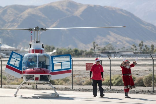 Santa Claus arrives via helicopter to visit children at the Palm Springs Air Museum on Sunday, December 15, 2019.