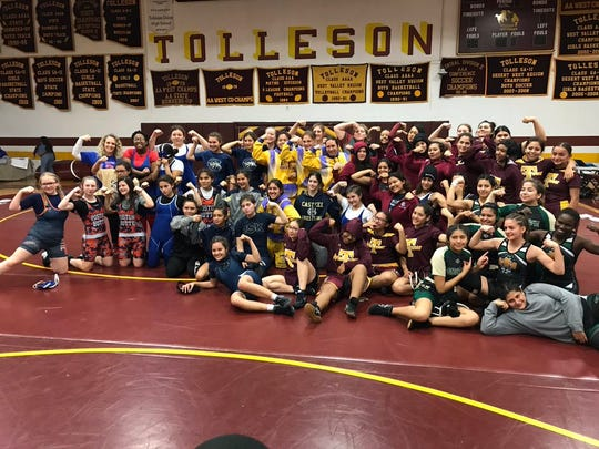 All of the girls wrestlers stand together at the end of the Tolleson All-Girls Classic wrestling tournament at Tolleson High School