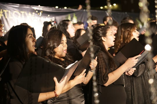 Choir members sing hymns during a performance that honored the growth of La Luz del Mundo, a religion based in Protestantism, at Civic Space Park on Dec. 14, 2019.