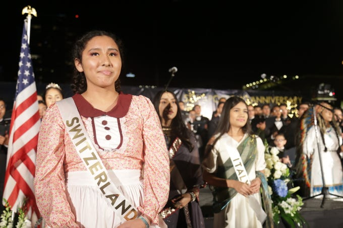 Abi Zavaleta, a member of Phoenix's congregation of La Luz del Mundo, represents Switzerland during a performance that honored the religion's international spread at Civic Space Park on Dec. 14, 2019.