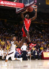 Georgia Bulldogs guard Anthony Edwards (5) slam-dunks the ball against Arizona State Sun Devils guard Rob Edwards (2) in the first half on Dec. 14, 2019 in Tempe, Ariz.