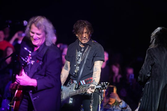 Michael Bruce and Johnny Depp perform with Alice Cooper at the 18th Annual Christmas Pudding at the Celebrity Theatre in Phoenix on Saturday, Dec. 14.