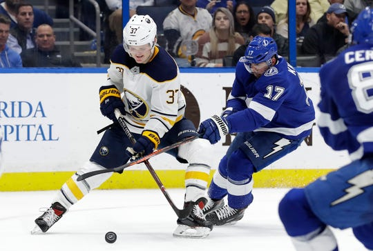 Tampa Bay Lightning left wing Alex Killorn (17) stick-hooks Buffalo Sabres center Casey Mittelstadt (37) during the third period of an NHL hockey game Thursday, Nov. 29, 2018, in Tampa, Fla. Mittelstadt has been assigned to Rochester.
