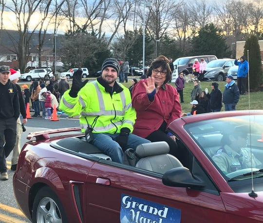 Gloria Moles (right), who almost died from cardiac arrest while participating in last year's Stuarts Draft Christmas Parade, was this year's grand marshal. To her left is Logan Parker, a paramedic with the Stuarts Draft Rescue Squad who helped save her life.