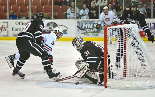 A shot by St. Cloud State's Nolan Walker skips past the UNO goal during the first period of the Saturday, Dec. 14, 2019, game at the Herb Brooks National Hockey Center in St. Cloud.