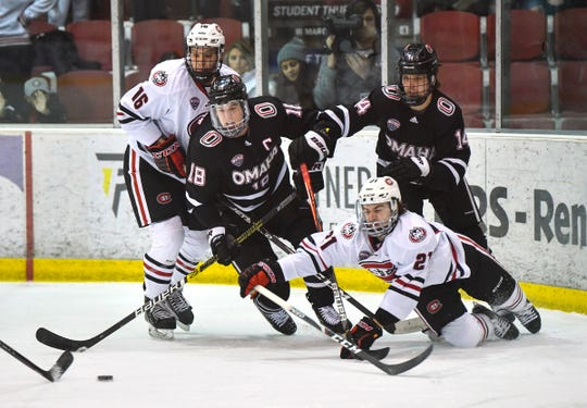 Players battle for control of the puck during the first period of the Saturday, Dec. 14, 2019, game against the University of Nebraska-Omaha at the Herb Brooks National Hockey Center in St. Cloud.