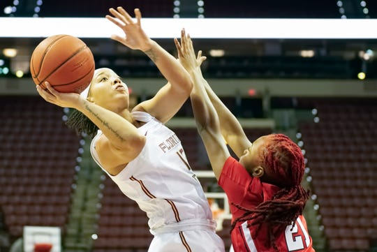 FSU guard Nausia Woolfolk shoots over Qadashah Hoppie of St. John's in a non-conference game on Sunday, Dec. 15, 2019.