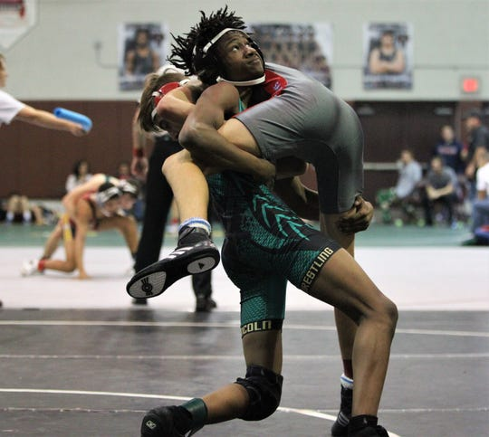 Lincoln's Elijah Hendley wrestles at the Capital City Classic wrestling tournament at Chiles High on Dec. 14, 2019.