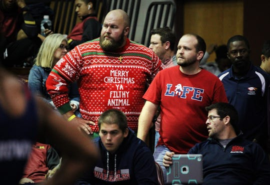 Wakulla wrestling coach Will Pafford (right) and assistant James Vernon watches during the Capital City Classic wrestling tournament at Chiles High on Dec. 14, 2019.