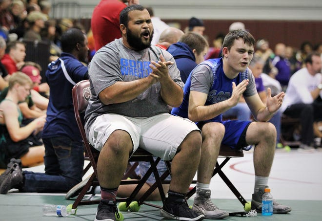 Godby wrestling coach MaShawn Knight applauds effort at the Capital City Classic wrestling tournament at Chiles High on Dec. 14, 2019.