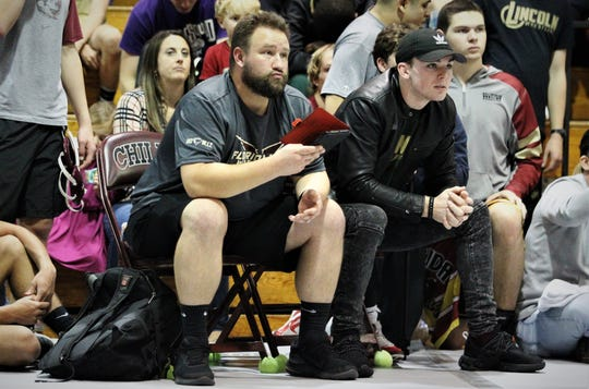 Florida High wrestling coach Clay Allen watches his wrestler during the Capital City Classic wrestling tournament at Chiles High on Dec. 14, 2019.