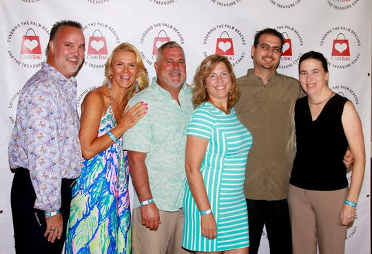 Tony Groza, left, Debbie Schmidt, Chris Couture, Nicole Couture, Tony Henderson and Haley Henderson at CareBag's Wonderland Gala atTradition Town Hall in Port St. Lucie.