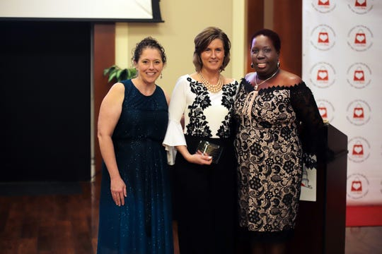 """Heather Gunnell, left, Heidi Lee and CareBag CEO Rozanne """"Roxy"""" Brown at the Wonderland Gala atTradition Town Hall in Port St. Lucie."""