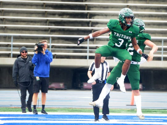 Nohl Williams (3) celebrates a score with R.J. Maria during Pacifica's 34-6 win over McClymonds in the CIF Division 2-A state championship bowl at Cerritos College in Norwalk on Saturday afternoon.