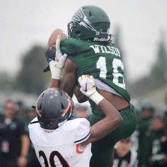 Pacifica High's Kyrie Wilson makes a touchdown catch during the Tritons' 34-6 win over McClymonds in the CIF Division 2-A state championship bowl at Cerritos College in Norwalk on Saturday afternoon.