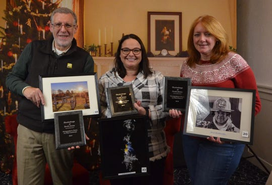 The Shutterbugs of South Jersey recently held its annual banquet and announced winners of the yearlong contest: (From left) Bart Feldman with his winning landscape category photo, A New Dawn: Gettysburg Cannon; Lynnette Raphael with her winning open category photo, Warbler in Light; and Susan Jesset with her winning portrait category photo, One of Vineland's Finest.