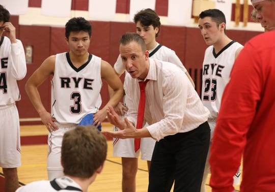 Rye High School boys basketball coach John Aguilar during the boys championship game against White Plains, at the 8th annual Harrison Holiday Basketball Tournament at Harrison High School, Dec. 14, 2019. White Plains beat Rye, 73-54.