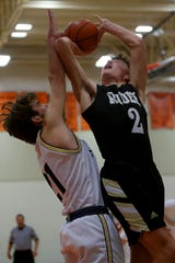 Rider's Jed Castles takes the shot over Highland Park's Worthey Wiles Saturday, Dec. 14, 2019, in Burkburnett's Union Square Bulldog Classic Championship game.