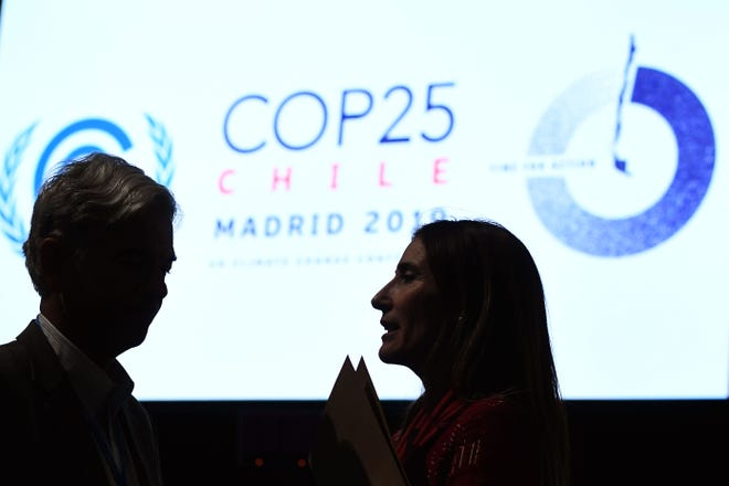 Chilean Minister of Environment Carolina Schmidt, right, talks to Brazilian Secretary for National Sovereignty and Citizenship Fabio Mendes Marzano at the U.N. Climate Change Conference in Madrid on Dec. 15.