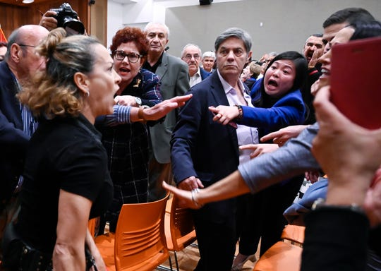 Pro-Trump supporters disrupt an appearance by Congressman Adam Schiff at a gathering of the Armenian National Committee of America on Dec. 14, 2019 in Glendale, Calif.