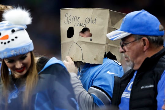 A Lions fan wears a paper bag on his head during the game against the Buccaneers.