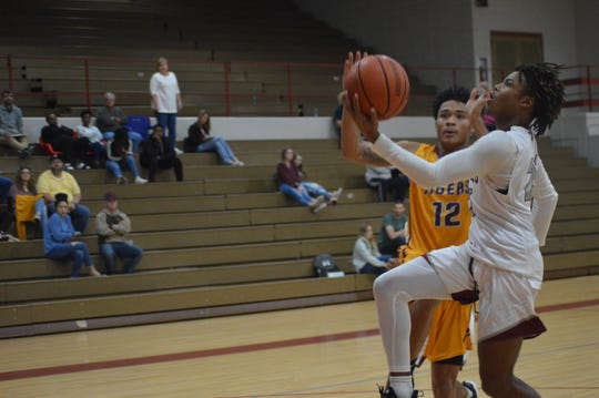Marksville's T'Darius Weaver (12) attempts to block a shot against Pineville during the Hixson Auto Invitational.