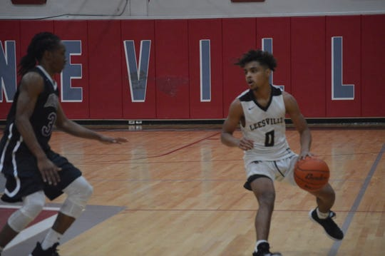 Leesville's Carlos Pagan (0) dribbles against Marksville during the Hixson Auto Invitational.