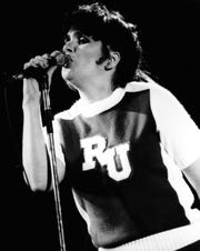 Linda Ronstadt dons a Rutgers cheerleders uniform as she performs during an October 28,1982, concert at the Rutgers Athletic Center in Piscataway, NJ.