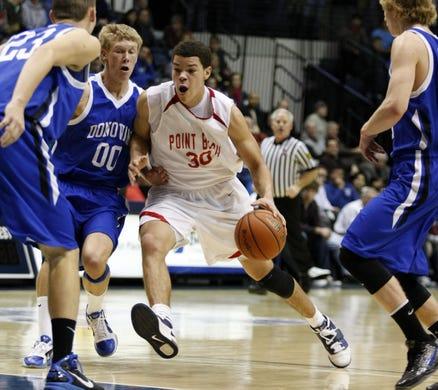 Point Beach's Jarelle Reischel (30) drives against Monsignor Donovan's Adam King (23) and Tim Mindnich in a 2011 game.