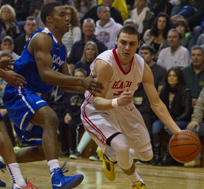 Lakewood's Amir Tyler guards Point Beach's Matt Farrell as Farrell dribbles the ball upcourt during the 2014 Shore Conference Tournament championship game at Monmouth University.