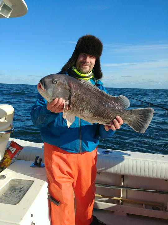 Ryan Loughlin with a 14-pound blackfish he caught the second week of December.