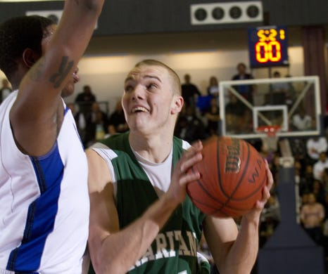 Raritan's Mike Aaman works in toward the basket against Lakewood's Daquan Kenney during first half action during a semifinal game during the 2011 Shore Conference Tournament.