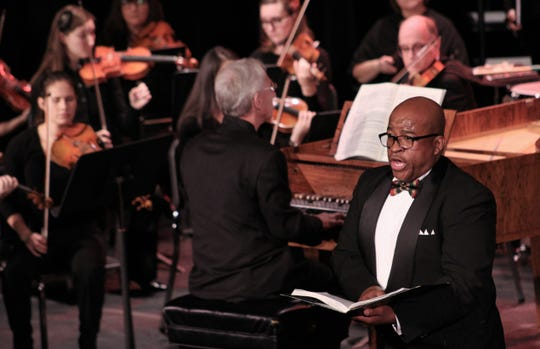 """Abilene Philharmonic conductor David Itkin leads musicians and singers during the December performance of """"Messiah"""" at the Paramount Theatre."""