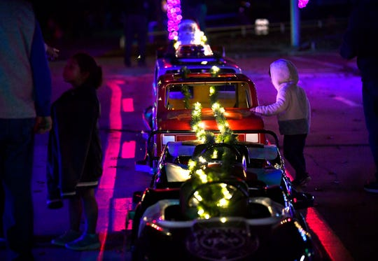Children investigate a line of lighted small cars at the Melvin Martin Center for Safety.