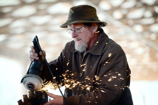 Don Shuford sharpens the blades on his saw at Sunrise Sawmill on Nov. 26, 2019.