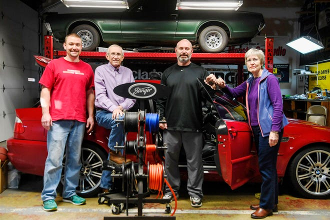 From left, Lovell, Gary, Chris and Jan Garner in the garage at Garner's Stereo Center December 11, 2019. Garner's originally opened in Asheville in 1973.