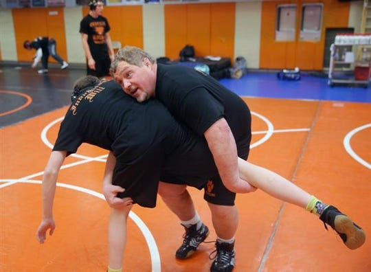 Former Central Kitsap wrestling coach Mike Harter died Dec. 15 at the age of 57.